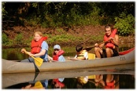 Photo of summer camp attendees in canoe